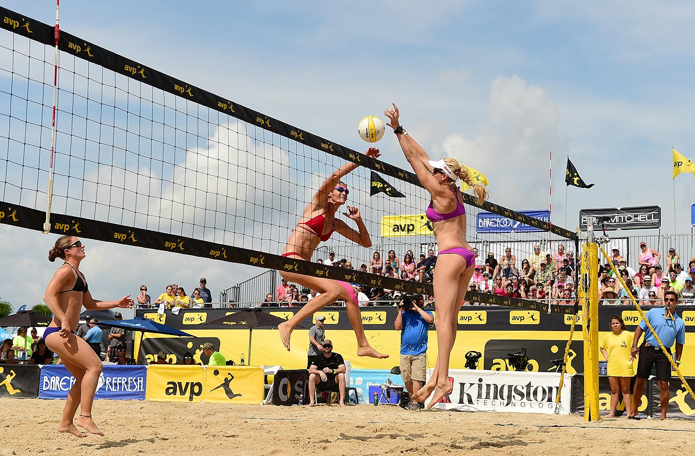 Kendra Van Zwieten watches Megan Wallin-Brockway try to put one past Kerri Walsh-Jennings.