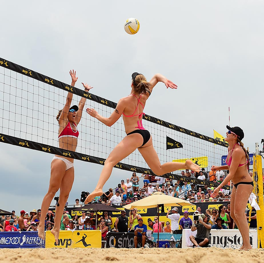 Scenes from the rain-plagued New Orleans AVP tournament, where April Ross and Kerri Walsh Jennings won their eighth straight event while Jake Gibb and Casey Patterson won the men's title.                                                      In this photo, Emily Day reaches to spike over April Ross.