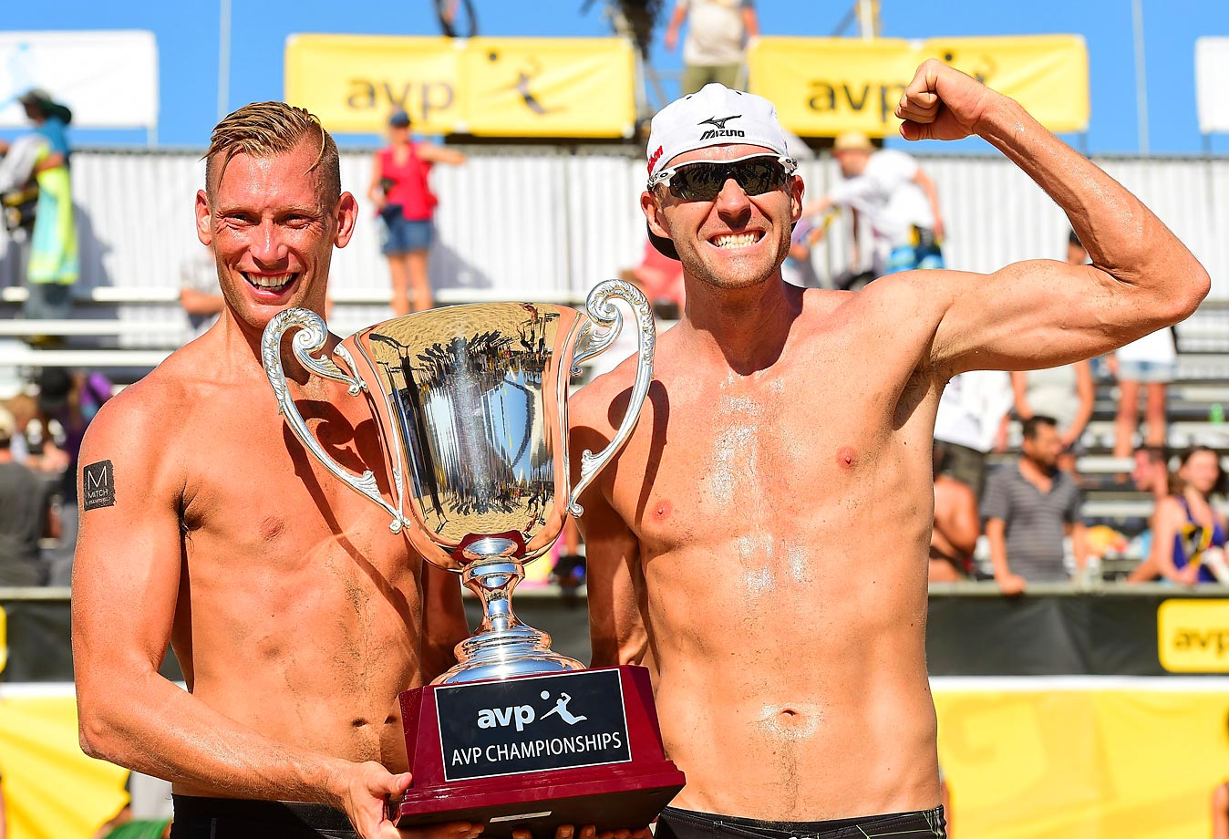 Casey Patterson (left) and Jake Gibb hoisting won their fourth AVP tournament of the year.
