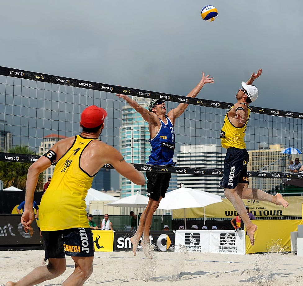 Adrian Gavira of Spain goes up for a spike over Stafford Slick of the U.S.