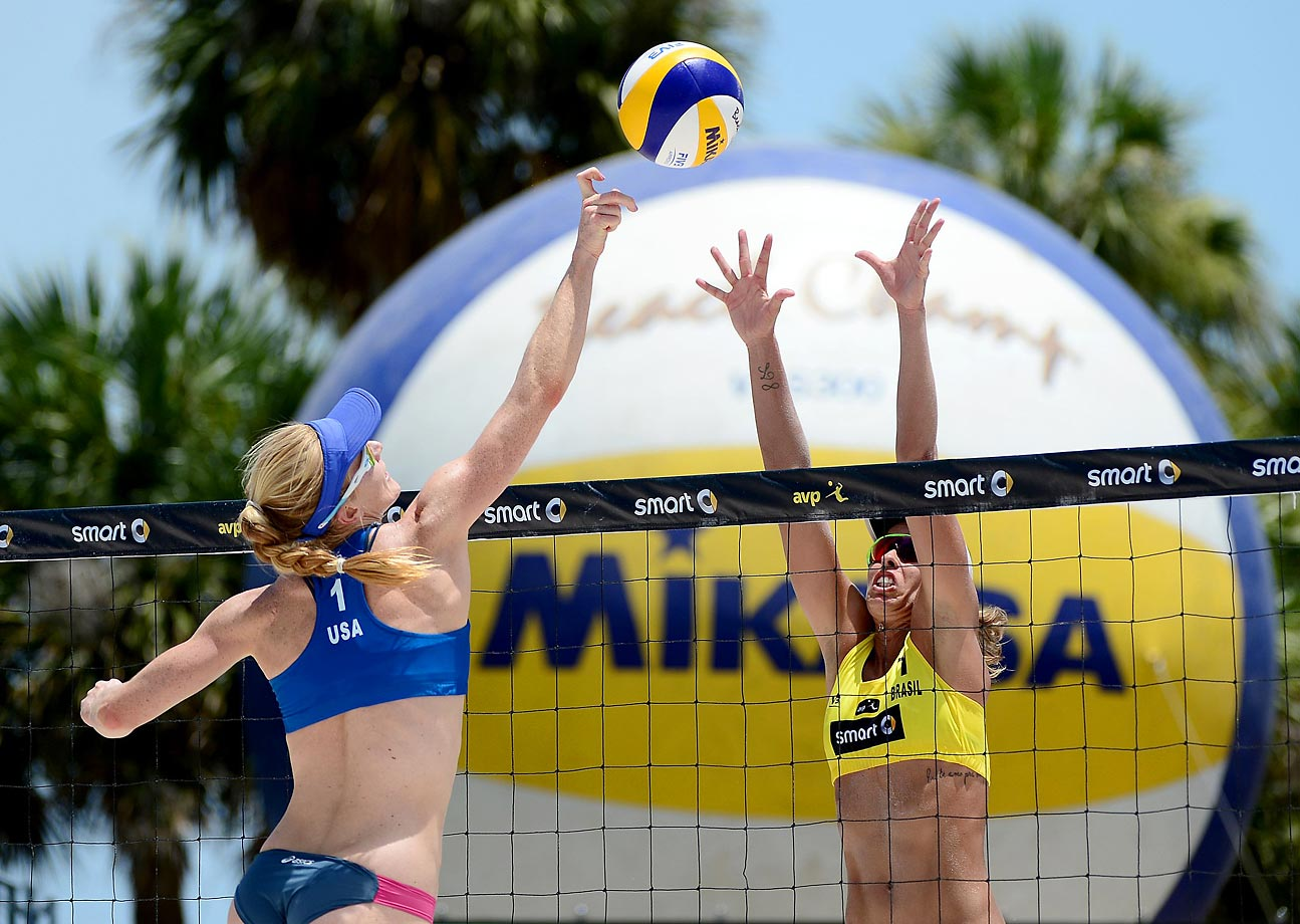 Kimberly Dicello of the U.S. goes up for a spike against Liliane Maestrini of Brazil.