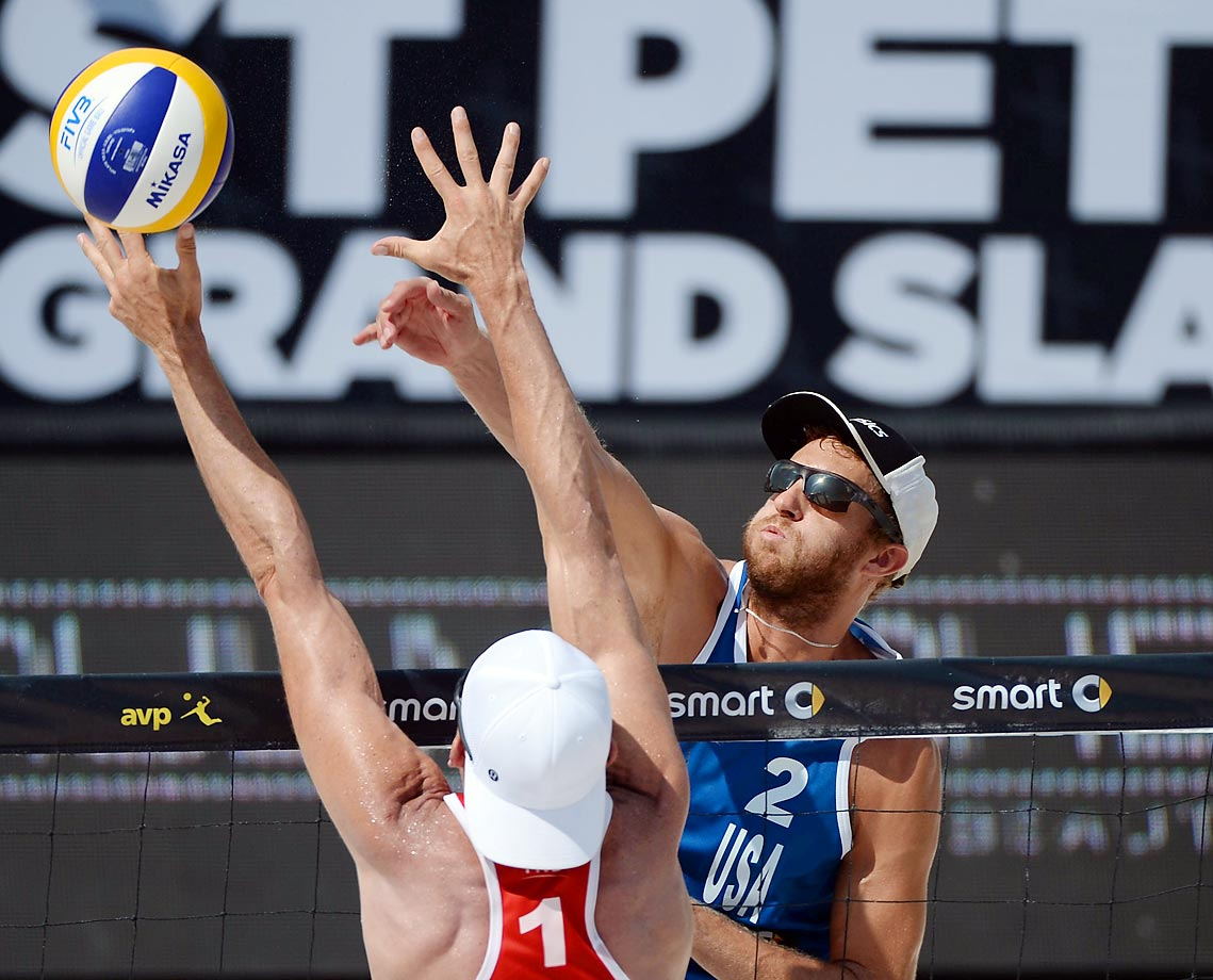 Theodore Brunner of the U.S. spikes the ball against Jake Gibb of the U.S. in the semifinals.