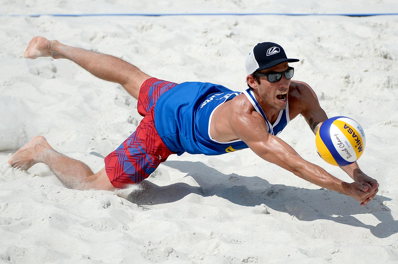 Nick Lucena of the U.S. makes a diving dig the ball in the semifinals.