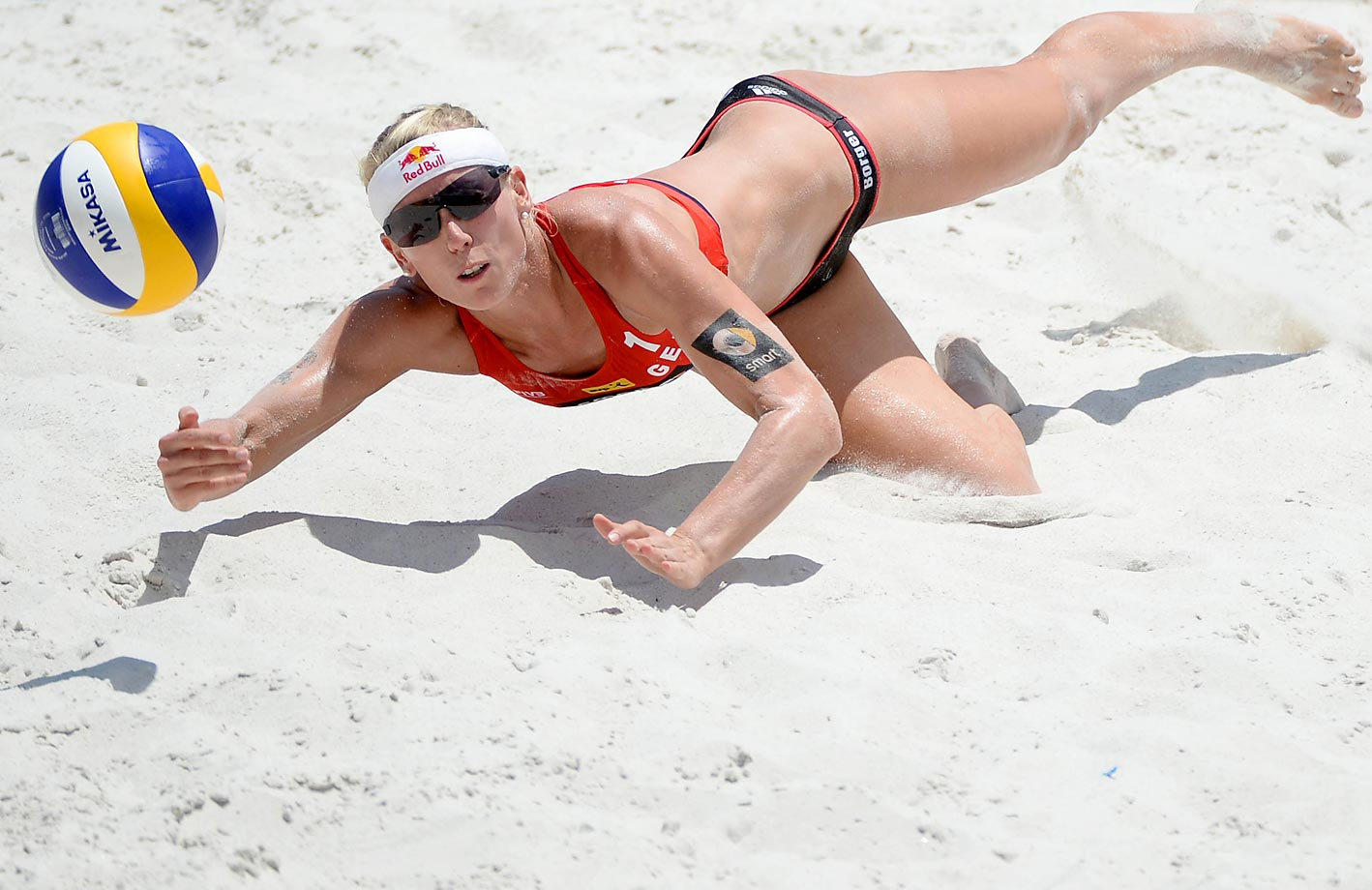 Karla Borger Of Germany dives for the ball during the semifinals.