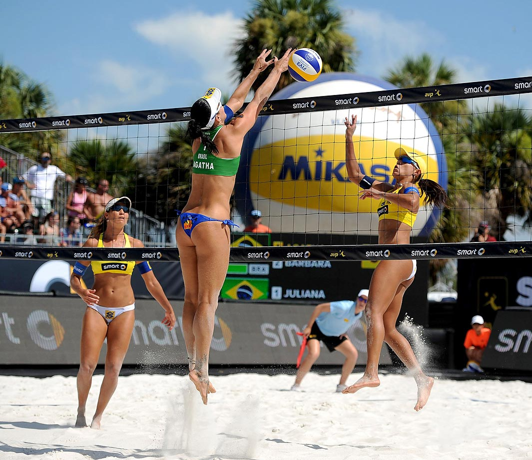 Agatha Bednarczuk of Brazil goes up for a block and Juliana Felisberta and Maria Antonelli of Brazil defend during the final.