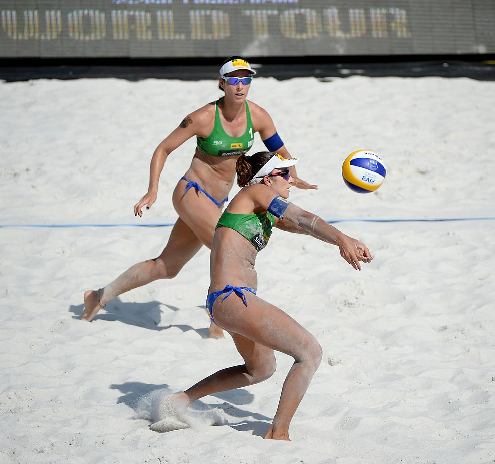 Barbara Seixas of Brazil bumps the ball while teammate Agatha Bednarczuk looks on.