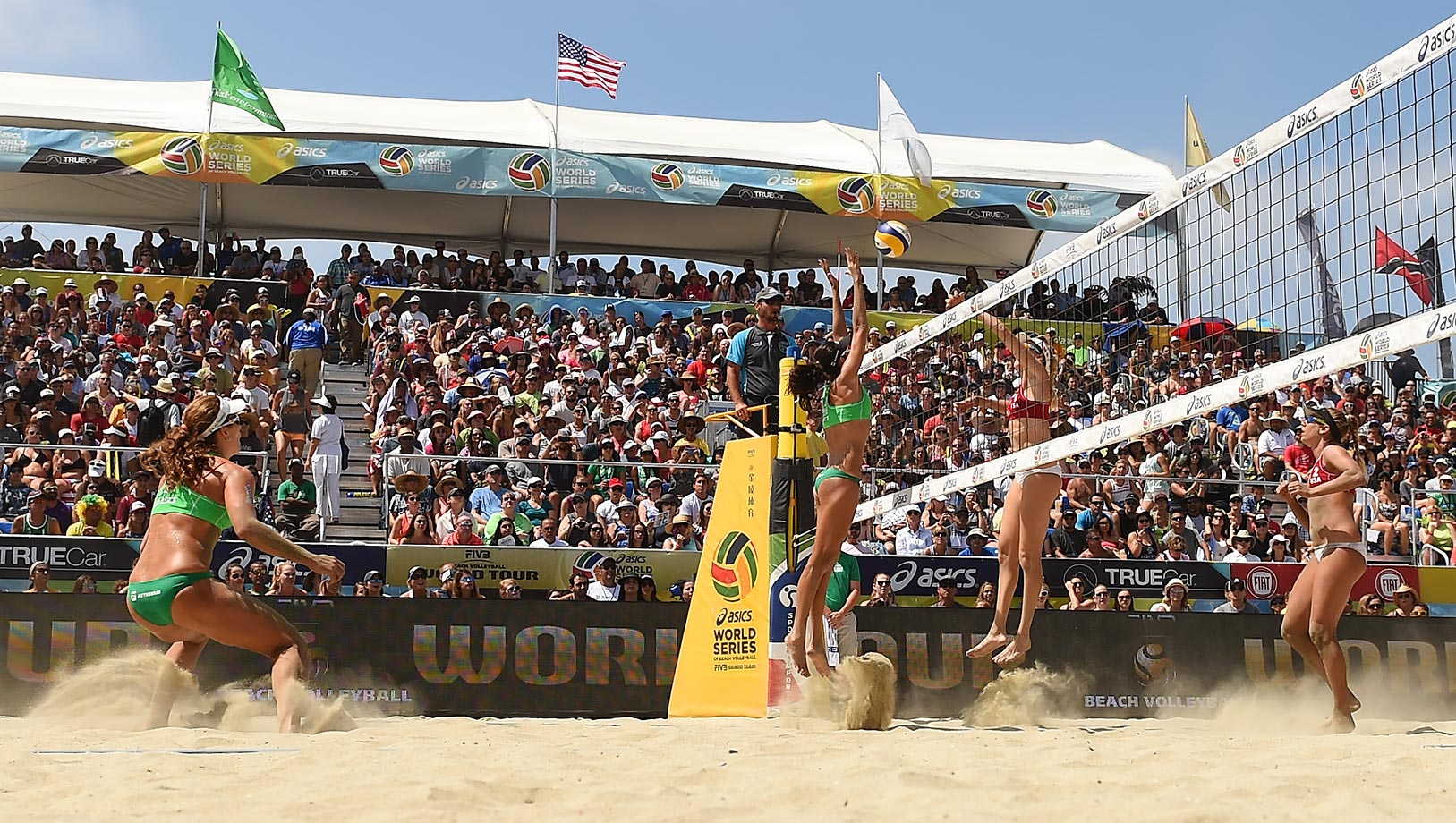 The women's final on Sunday. Kerri Walsh-Jennings played despite a severely injured right shoulder. She and partner April Ross took silver. Kerri hit left-handed and served underhand.
