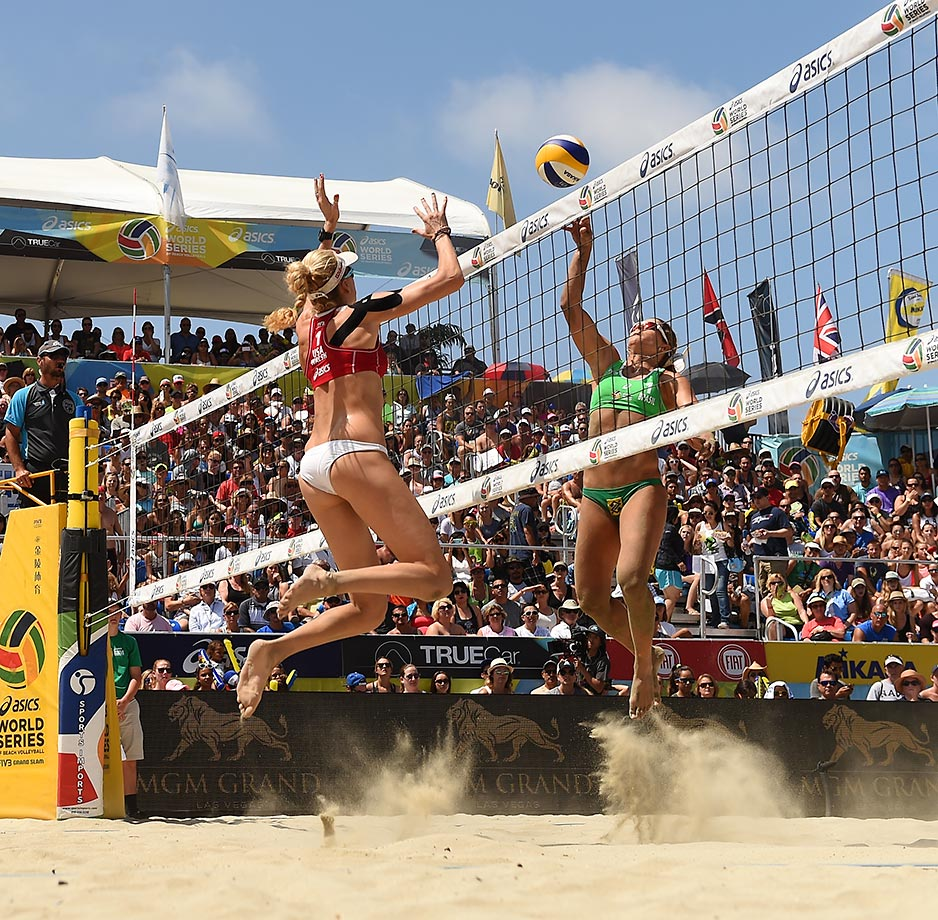 Larissa Franca of Brazil pokes one over Kerri Walsh-Jennings during the final.