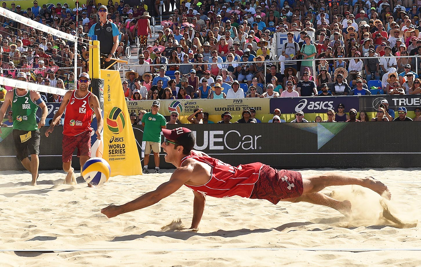 USA's Nick Lucena out flat for a dig in the final.