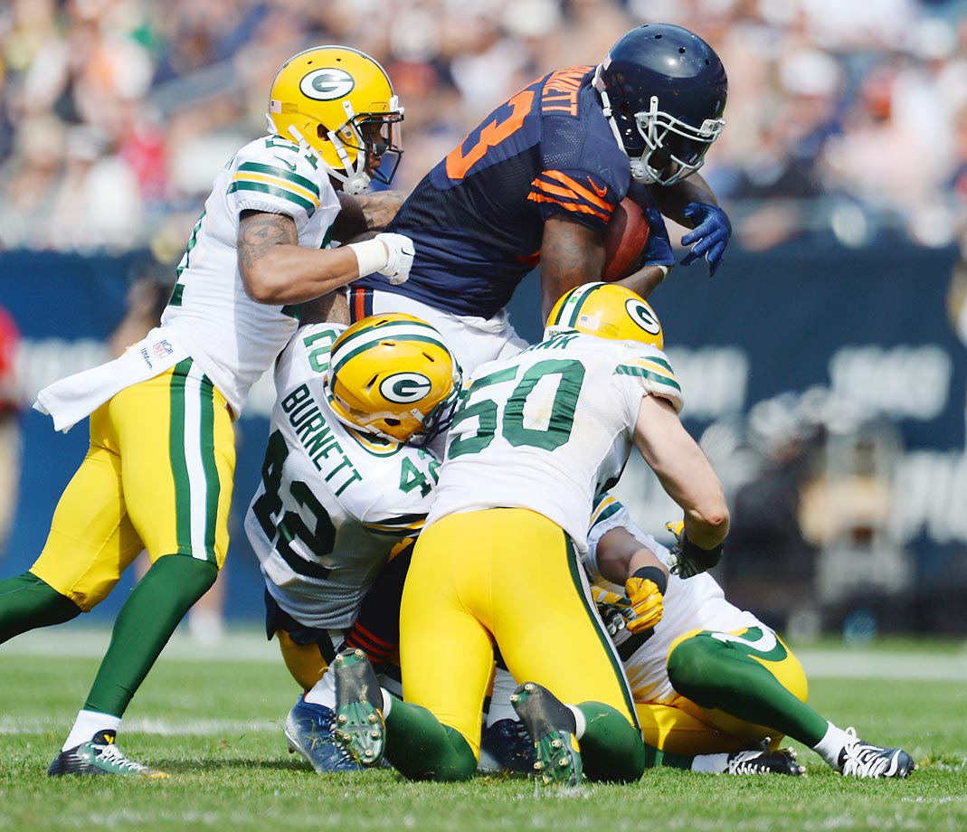 Packers defenders try to bring down Bears tight end Martellus Bennett. The Packers won 38-17 at Soldier Field.