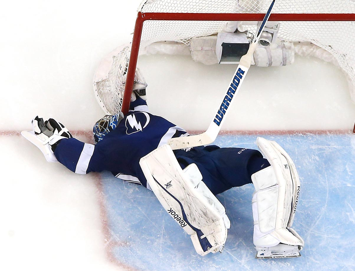 Ben Bishop of the Tampa Bay Lightning makes a save against the New York Rangers in Game 6.