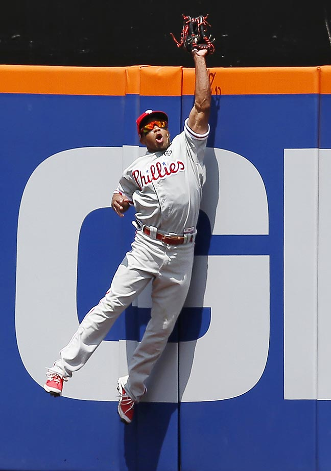 Philadelphia Phillies center fielder Ben Revere robs New York Mets' Lucas Duda  of a home run in the fourth inning of a baseball game in Queens, New York.
