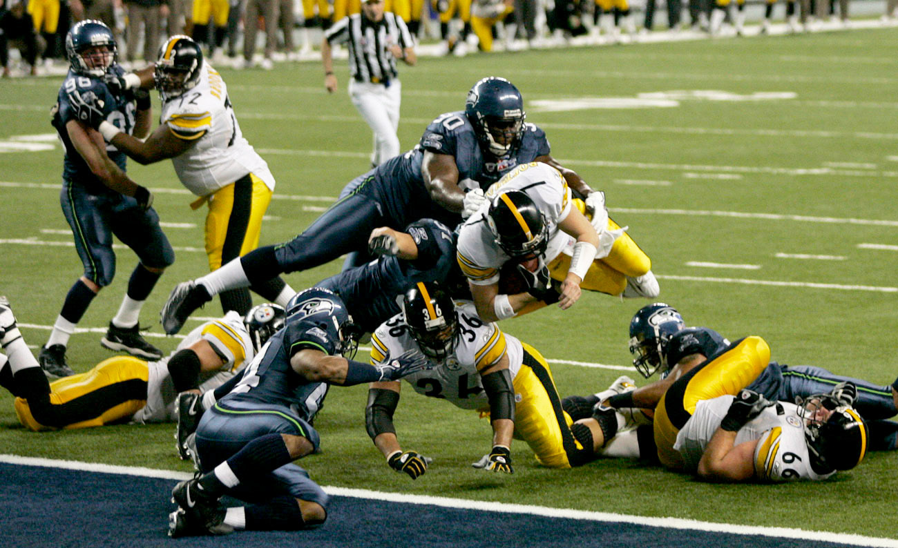 Roethlisberger goes airborne in search of the goal line.