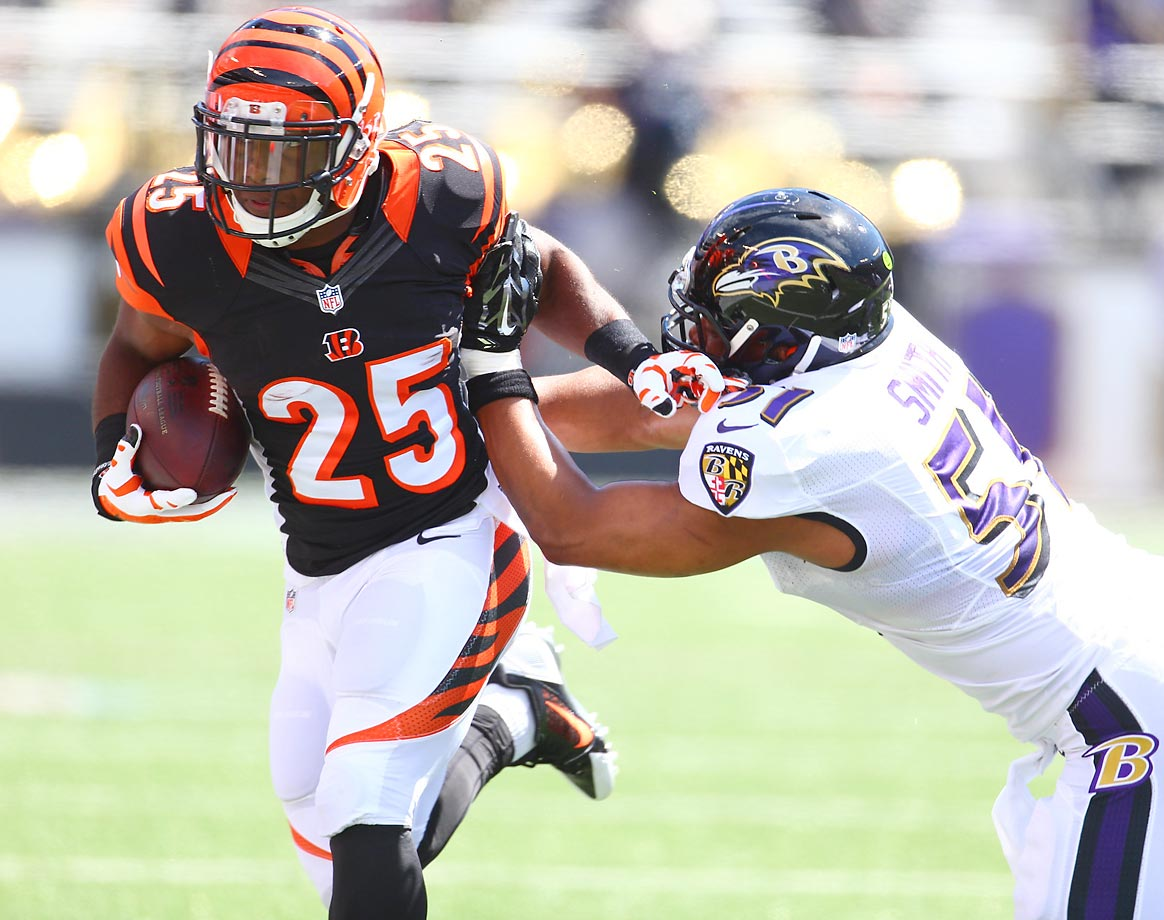 Giovani Bernard of the Bengals runs past Daryl Smith of the Ravens.