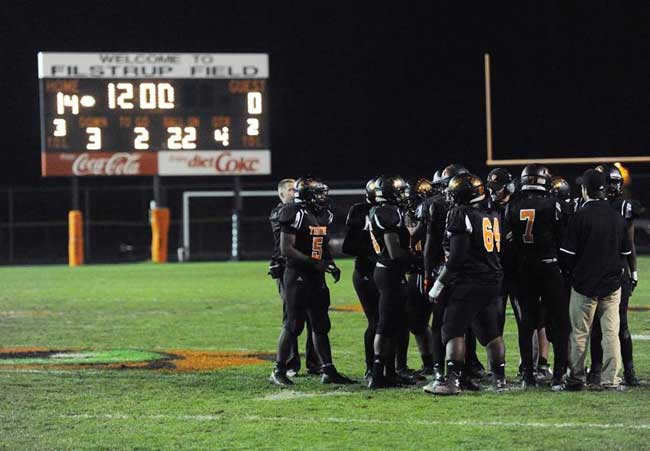 Percy Brown (No. 5) and the Tigers huddle up in the fourth quarter.