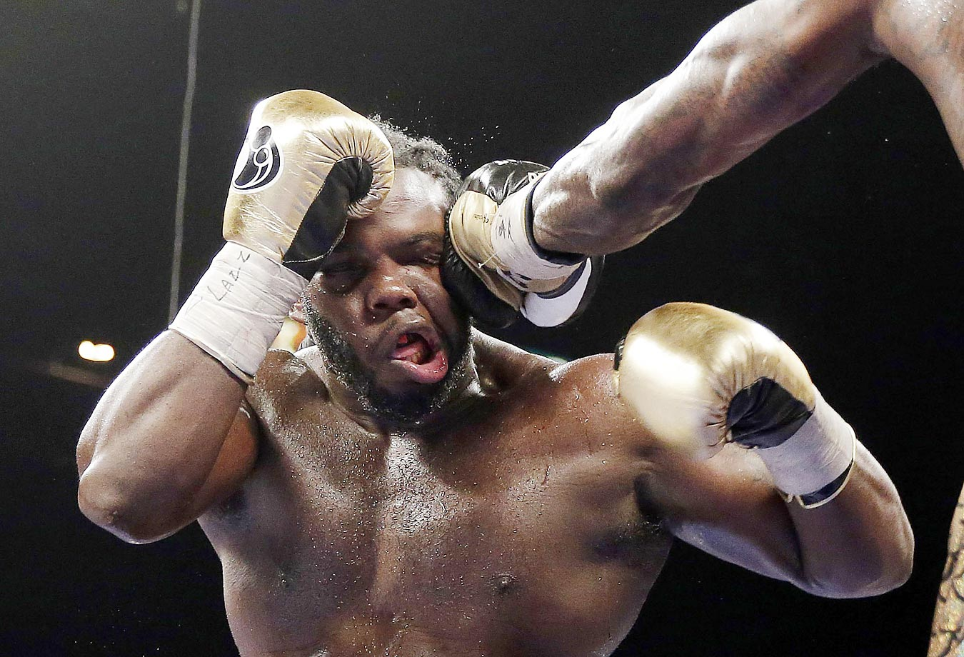 Bermane Stiverne takes a punch from Deontay Wilder during their WBC heavyweight championship match in Las Vegas. Wilder won by unanimous decision.