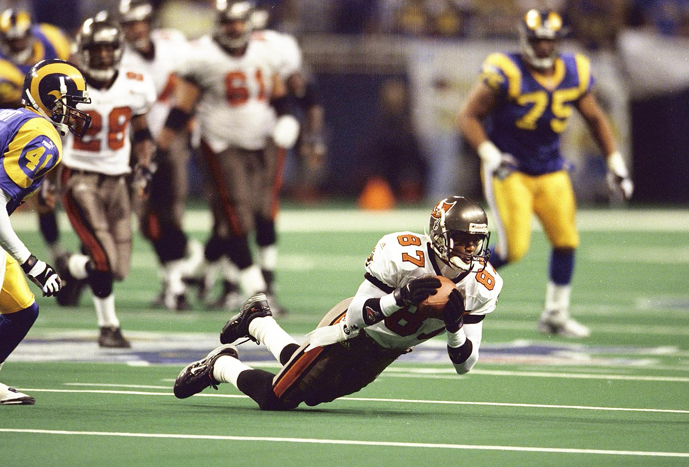 The ball can hit the ground and be considered a reception as long as the receiver maintains control of the ball. In the 1999 NFC Championship, Bert Emanuel's pass was ruled incomplete for touching the ground, and the Bucs lost the game two plays later. The controversial call prompted the NFL to enact the rule in the following season.