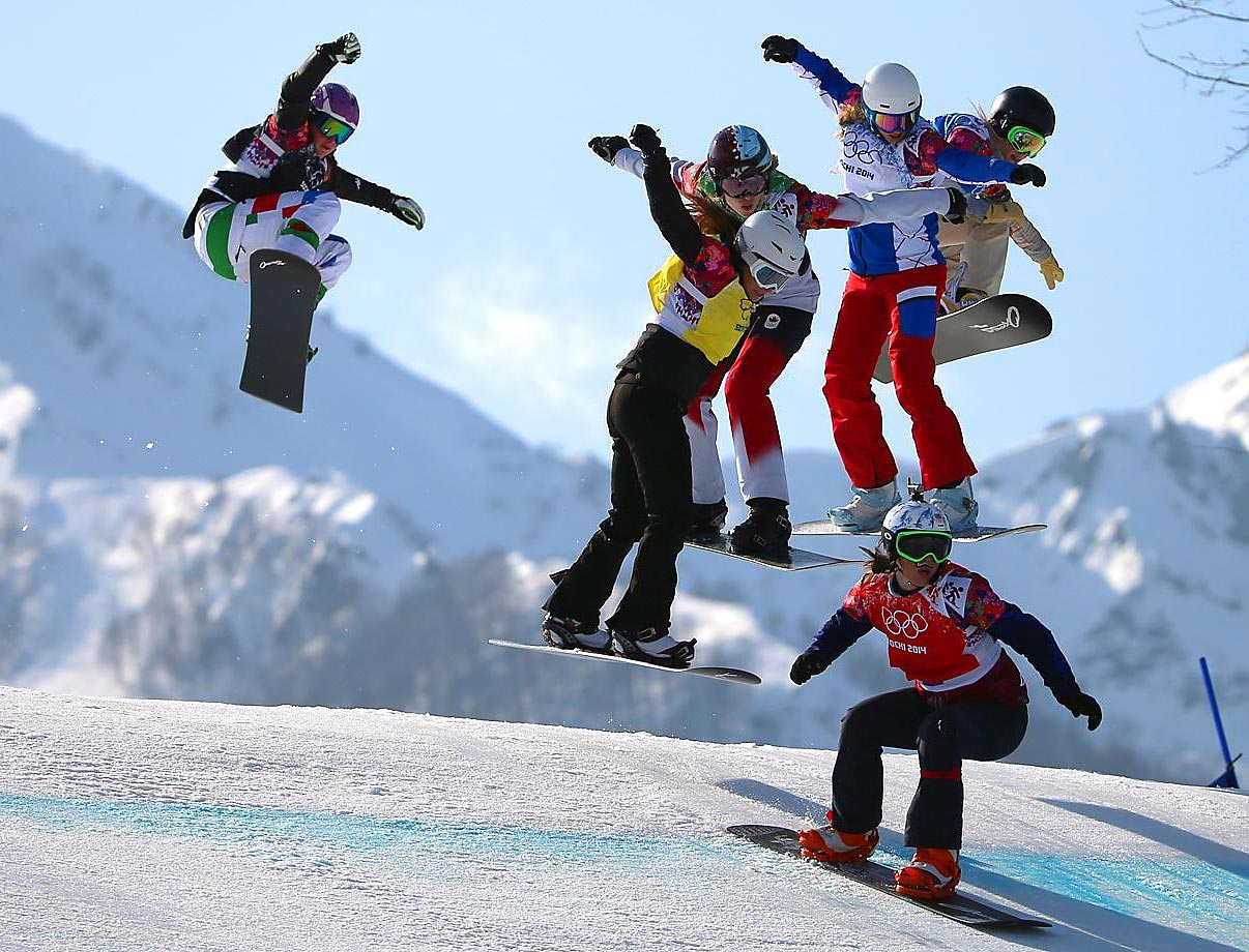 Competitors in the women's Snowboard Cross semifinals at the Winter Olympics.