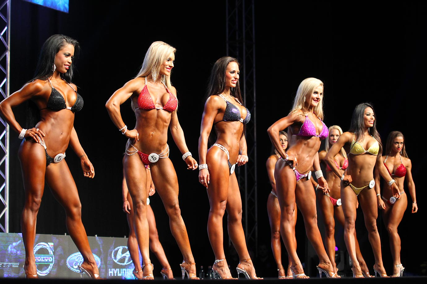 Competitors of the Pro Bikini category pose during the 3rd annual EVLS Prague Pro 2014 bodybuilding contest.