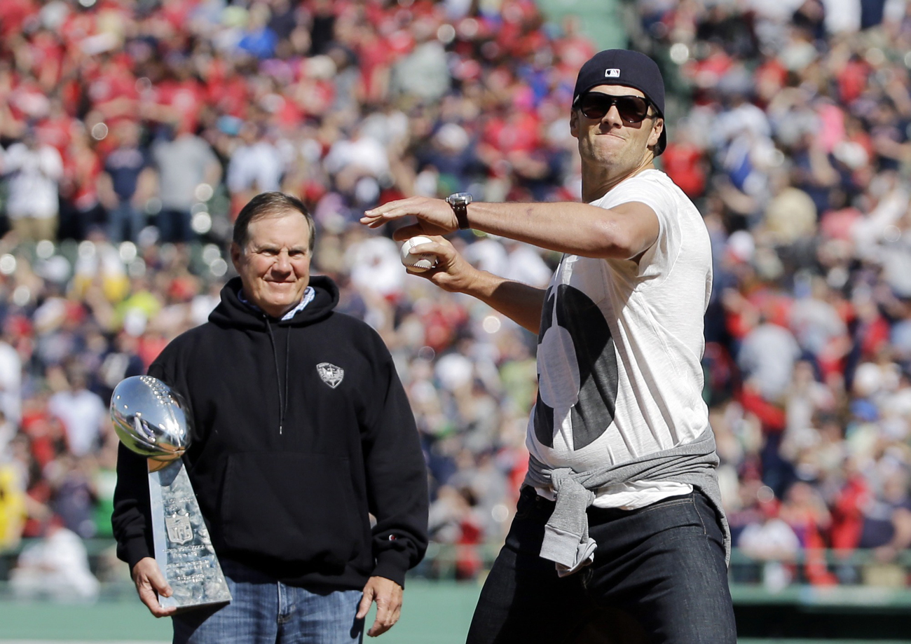First pitch at Fenway, Lombardi in tow, April 2015. (Photo: Elise Amendola/AP)
