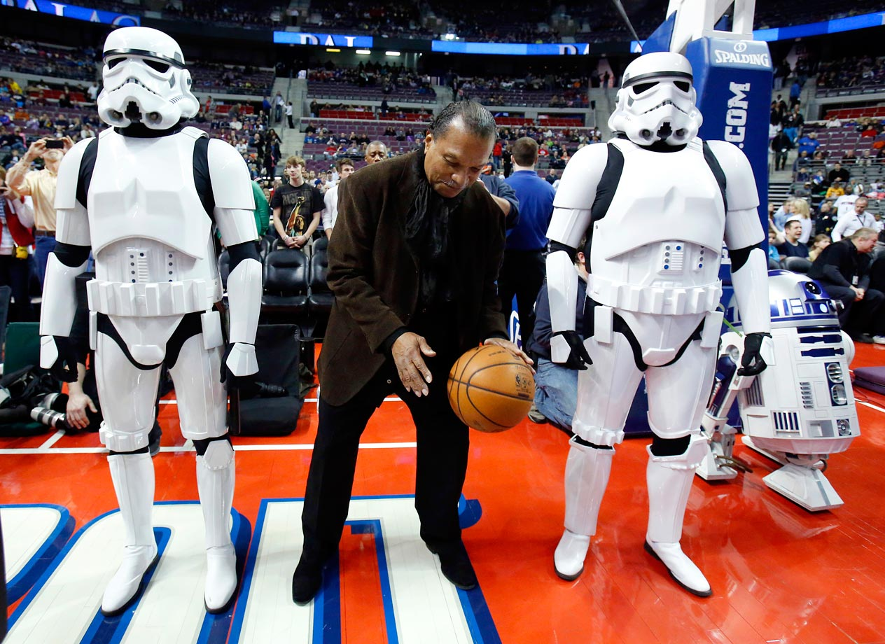 "Billy Dee Williams is flanked by stormtroopers and R2-D2 while dribbling a basketball before the Detroit Pistons game against the Atlanta Hawks on ""Star Wars Night"" on Jan. 4, 2013 at the Palace of Auburn Hills, Mich."