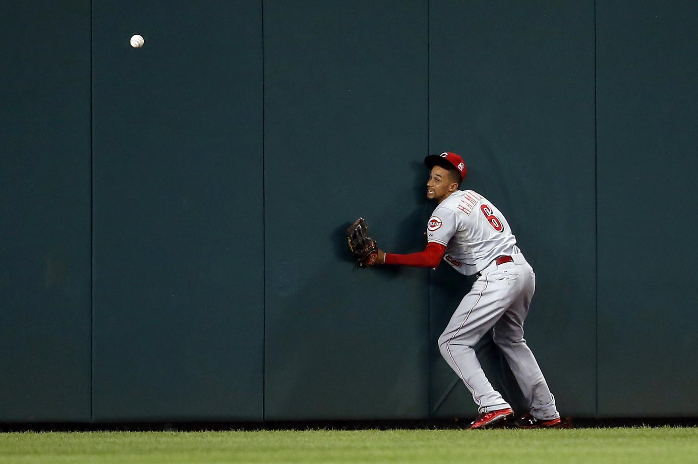 Billy Hamilton of the Cincinnati Reds bounces off the wall in a game against the Washington Nationals.