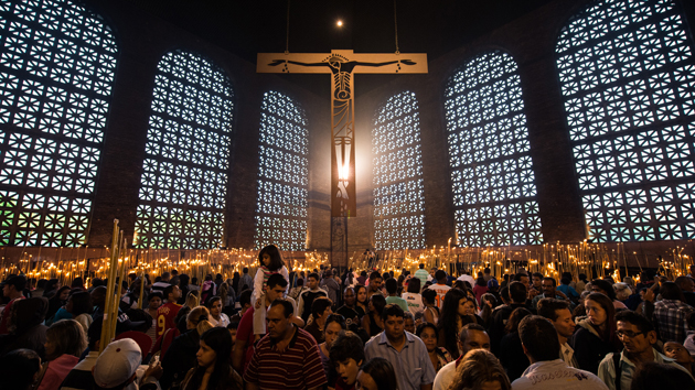 Faithful observers light candles at the National Shrine of Our Lady Aparecida.