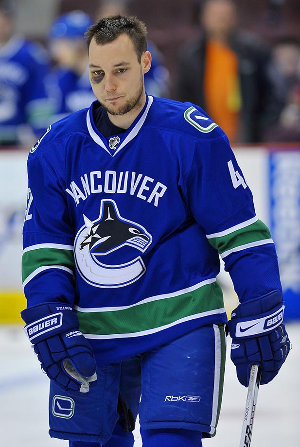 Kyle Wellwood of the Vancouver Canucks skates during a 2009 game against the Calgary Flames.