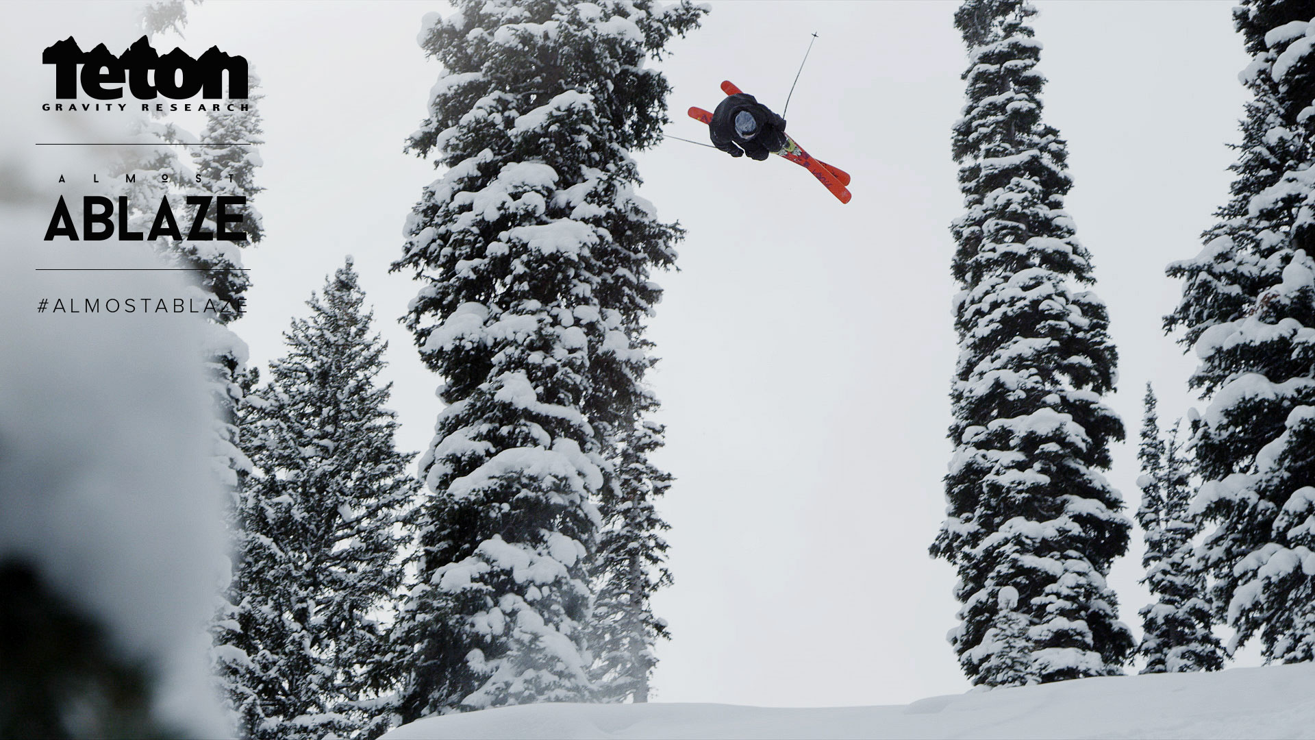 A skiier performs a front-flip.