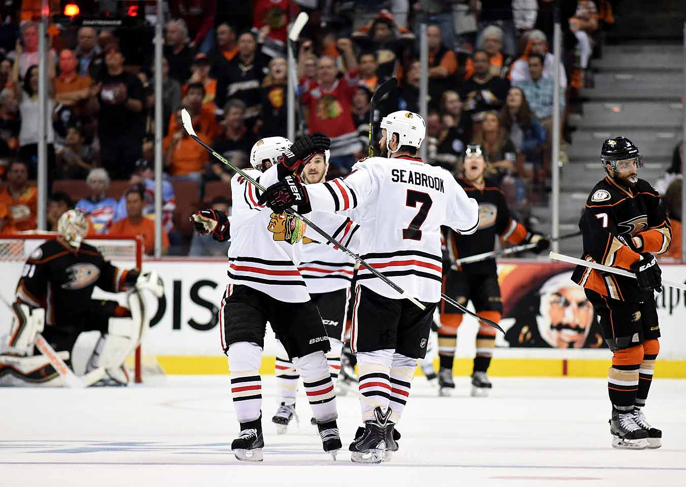 Extended to seven games by the Ducks, the Blackhawks jump out to a 2-0 lead in Anaheim thanks to a pair of goals by Jon Toews and hold on for a 5-3 win that sends them the Stanley Cup Final where they take on the Tampa Bay Lightning.