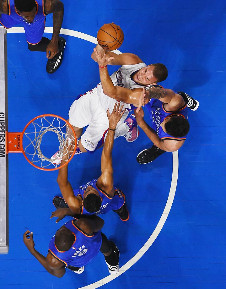 Blake Griffin gets fouled by the Thunder in the Clippers' season-opening 93-90 victory.