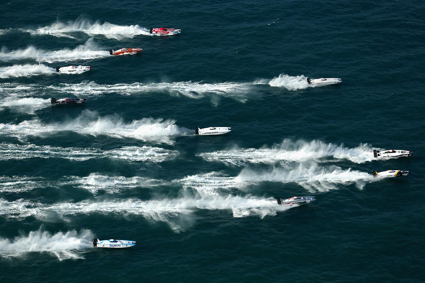 Competitors racing in the Abu Dhabi Grand Prix of the UIM XCAT World Series, where 14 boats are competing. XCAT, short for extreme catamaran, is one of the most challenging and extreme forms of powerboat racing in the world.