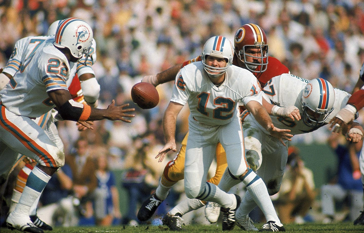 Miami Dolphins quarterback Bob Griese pitches the ball during Super Bowl VII against the Washington Redskins in January 1973.
