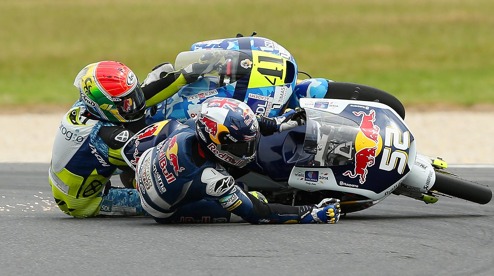 Brad Binder of South Africa and Danny Kent of Great Britain at the 2014 MotoGP of Australia.