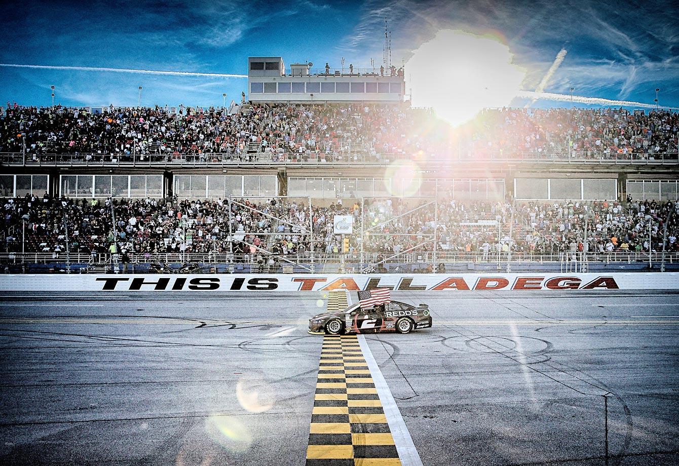 Brad Keselowski celebrates after winning a NASCAR Sprint Cup Series race at Talladega Superspeedway.
