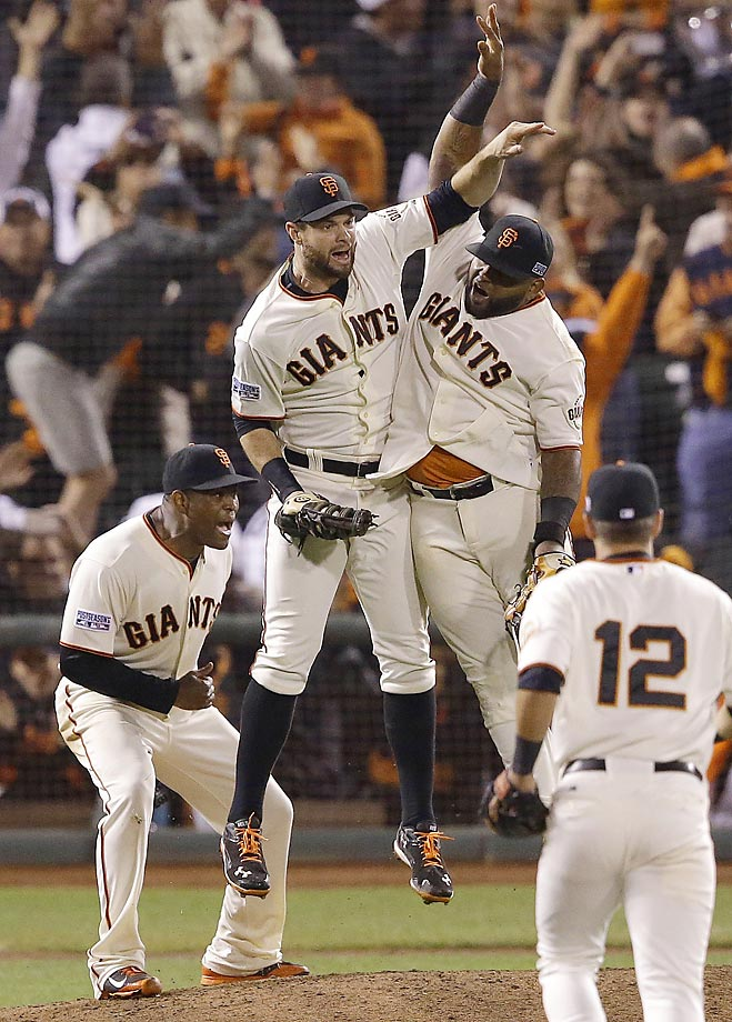 San Francisco Giants' Brandon Belt, Pablo Sandoval, Santiago Casilla and Joe Panik celebrate after winning Game 4 of the National League Division Series against the Washington Nationals and advancing to the NLCS.