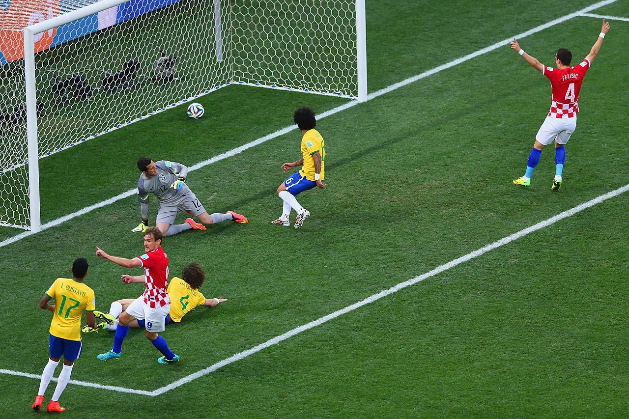 Nikica Jelavic and Ivan Perisic of Croatia celebrate as Julio Cesar, David Luiz and Marcelo of Brazil watch a deflected shot cross the goal line.