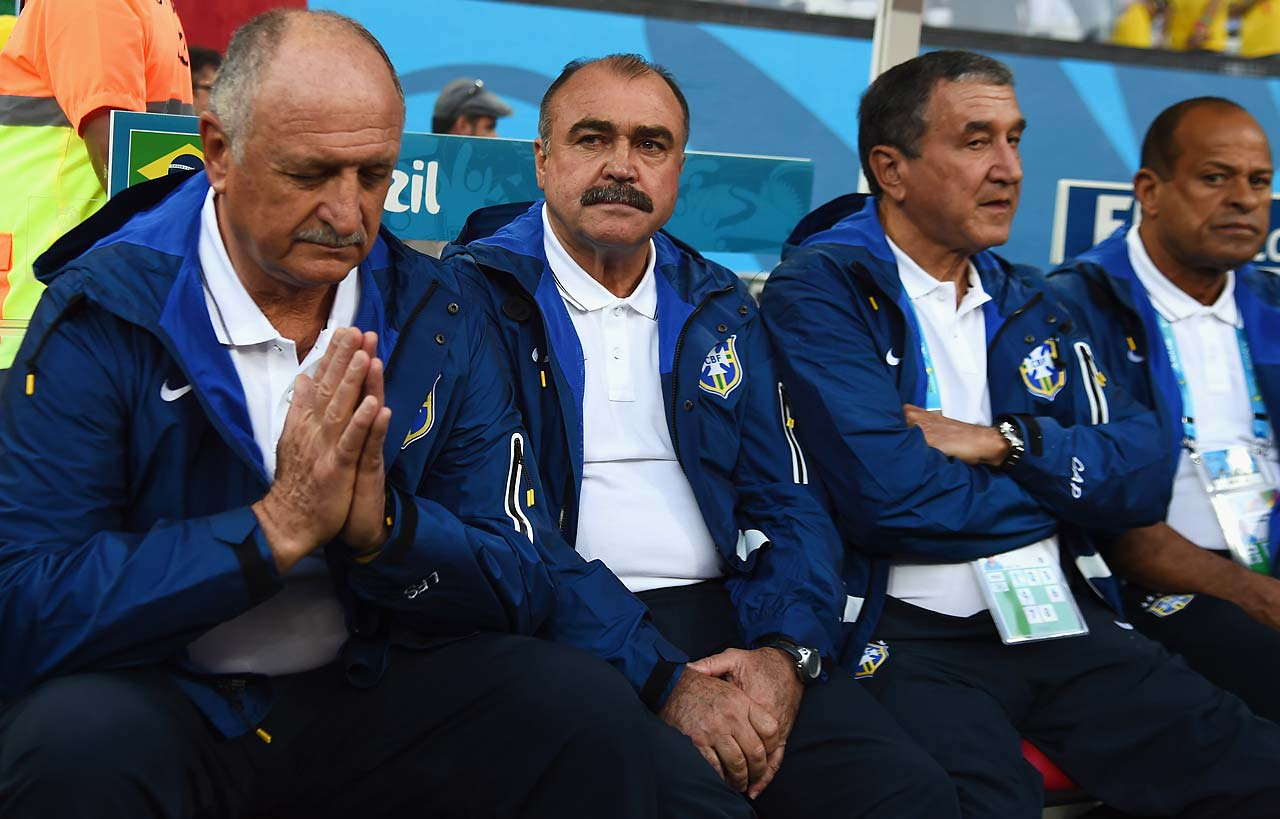 Head coach Luiz Felipe Scolari of Brazil sits at the start of the opening game.