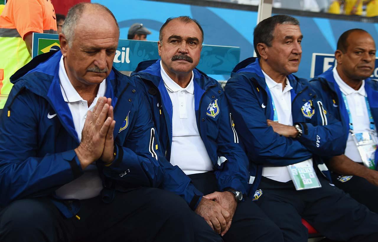 Head coach Luiz Felipe Scolari of Brazil sits at the start of the opening game.