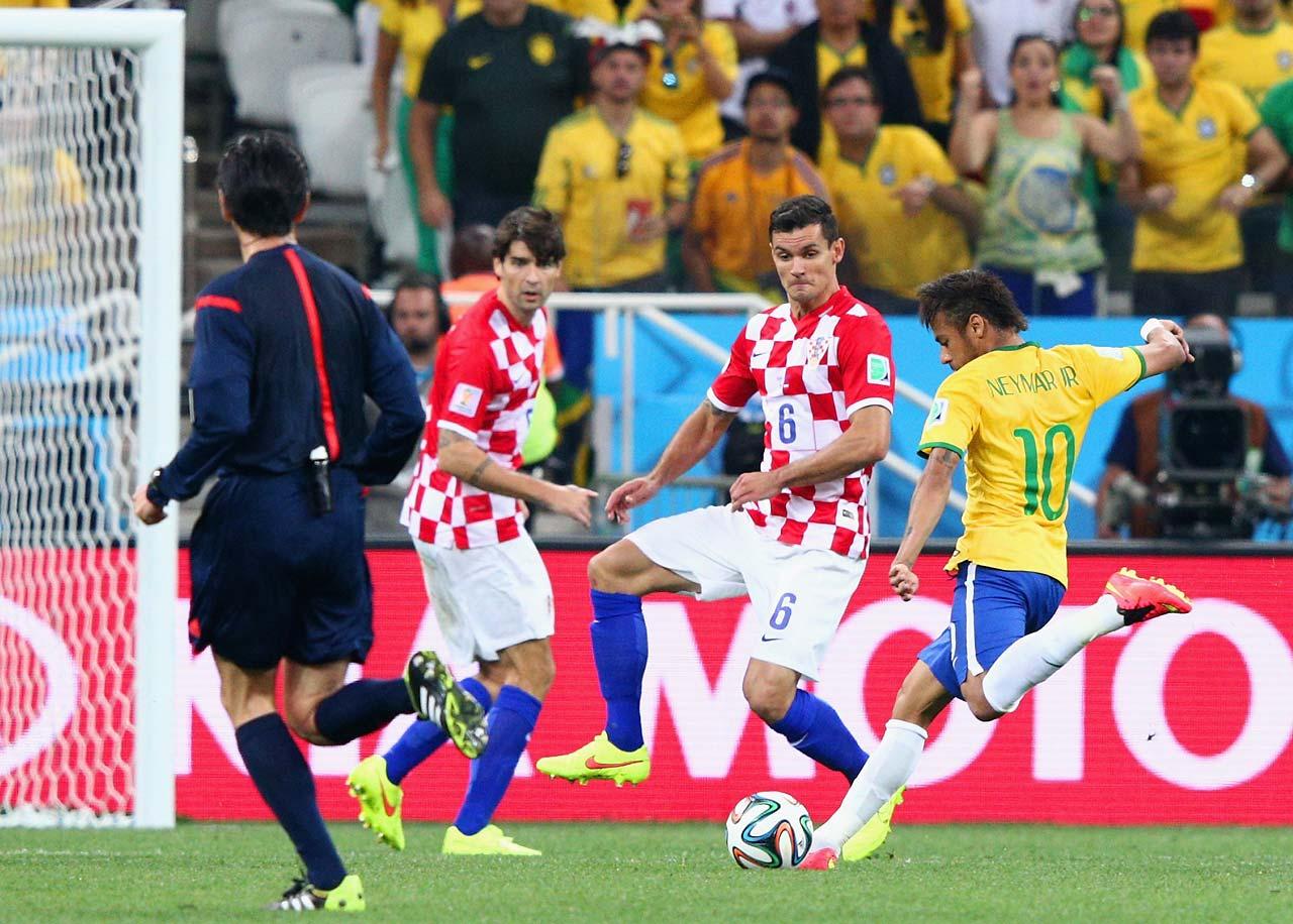 Neymar shoots and scores against Dejan Lovren of Croatia in the first half.