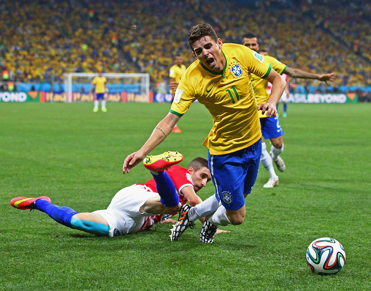 Oscar of Brazil is tripped up by Sime Vrsaljko of Croatia in the second half.