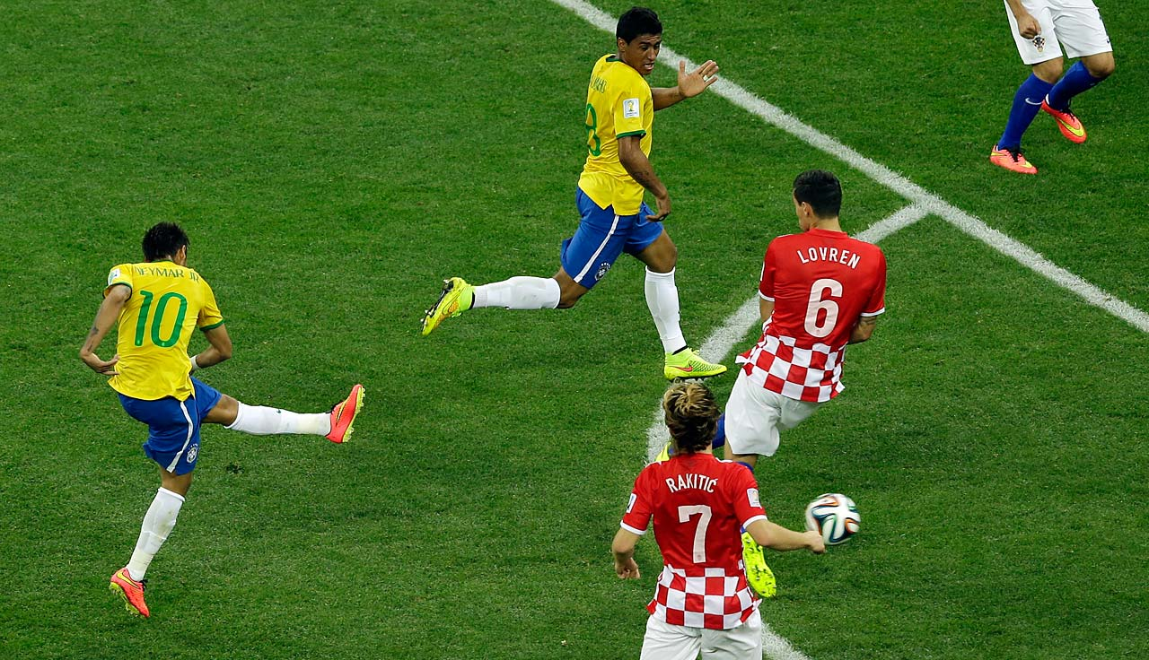 Brazil's Neymar scores his side's first goal.