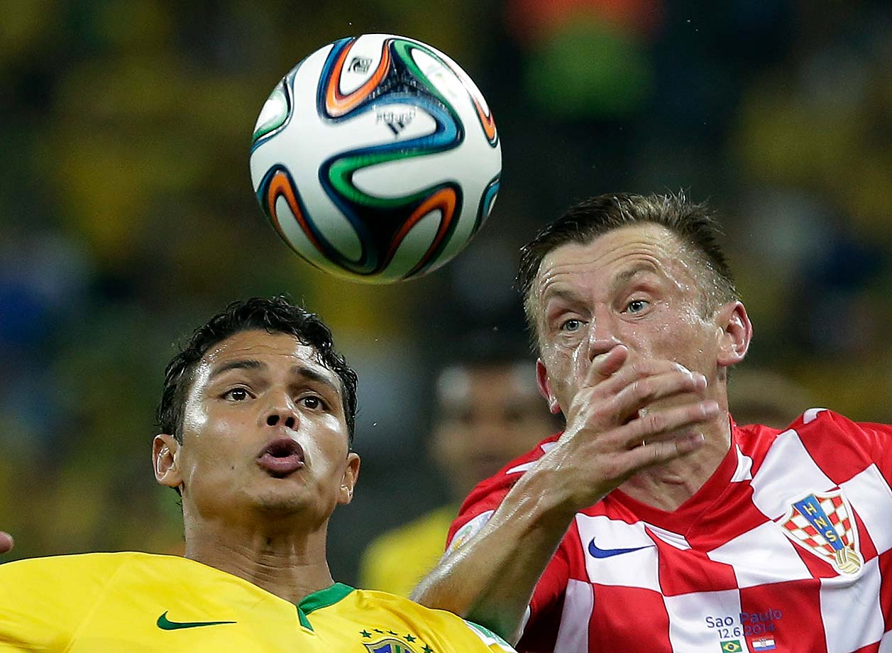 Brazil's Thiago Silva, left, and Croatia's Ivica Olic battle for the ball.