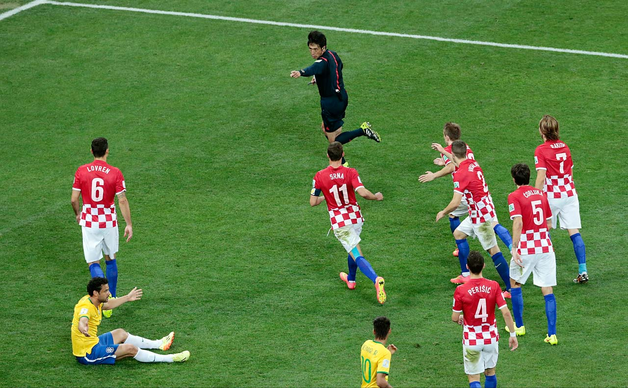 Referee Yuichi Nishimura from Japan called a questionable foul against Brazil's Fred, which led to Brazil's second score.
