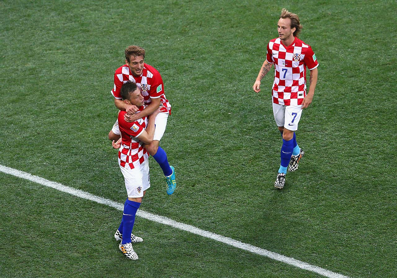Croatia players (from left Ivica Olic, Nikica Jelavic and Ivan Rakitic celebrate.