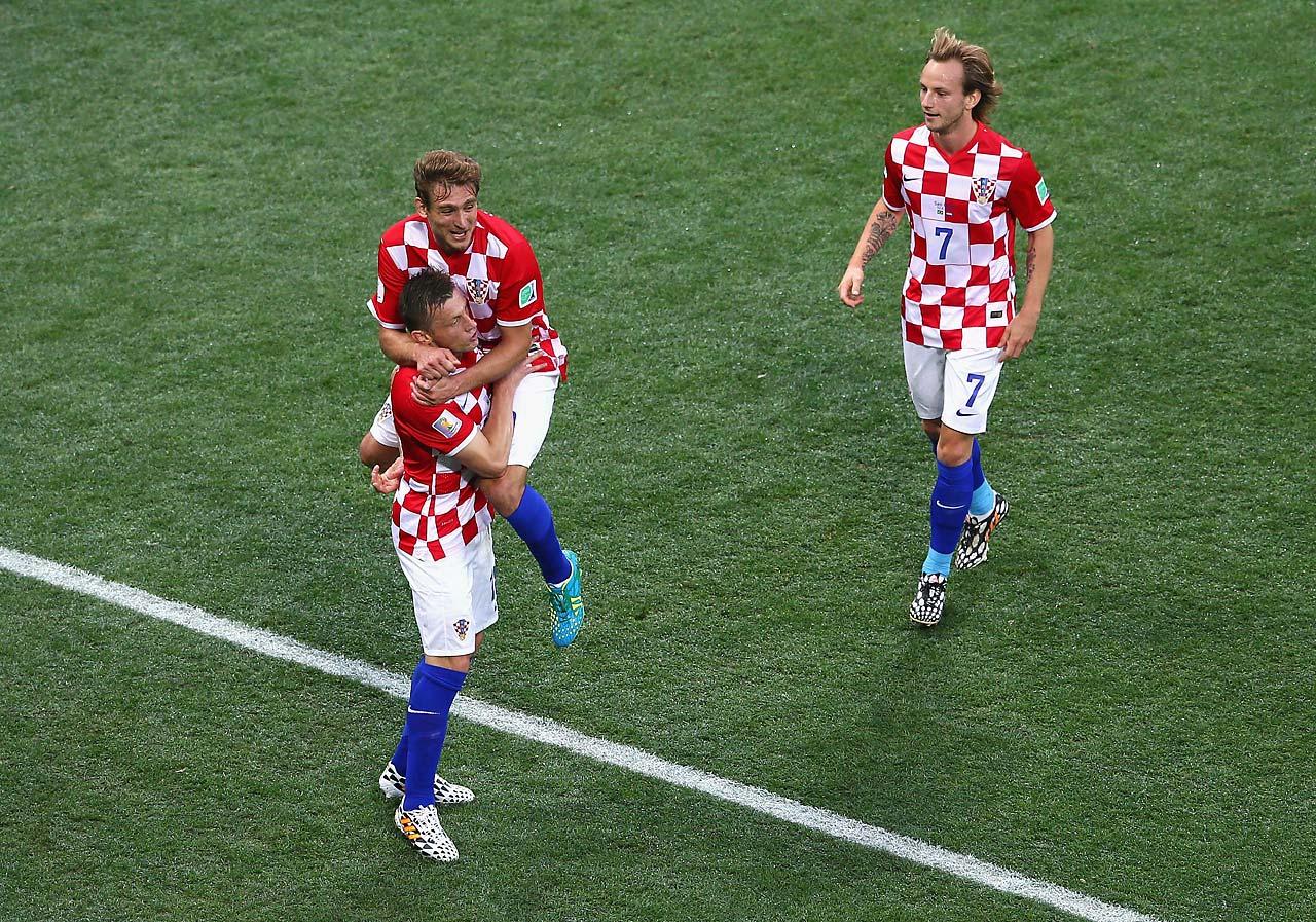 Croatia players (from left Ivica Olic, Nikica Jelavic and Ivan Rakitic celebrate.