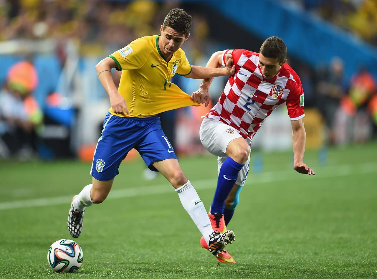 Oscar of Brazil fights off Sime Vrsaljko of Croatia in the first half.