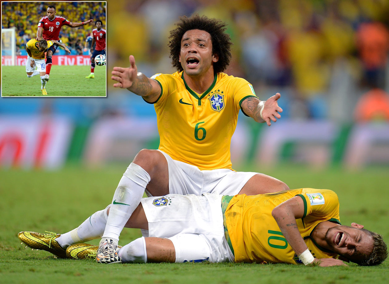 Neymar is kneed in the back by Colombia's Juan Camilo Zuniga, causing teammate Marcelo to call for help and fracturing a vertebra that rules him out for the rest of the World Cup in the process.