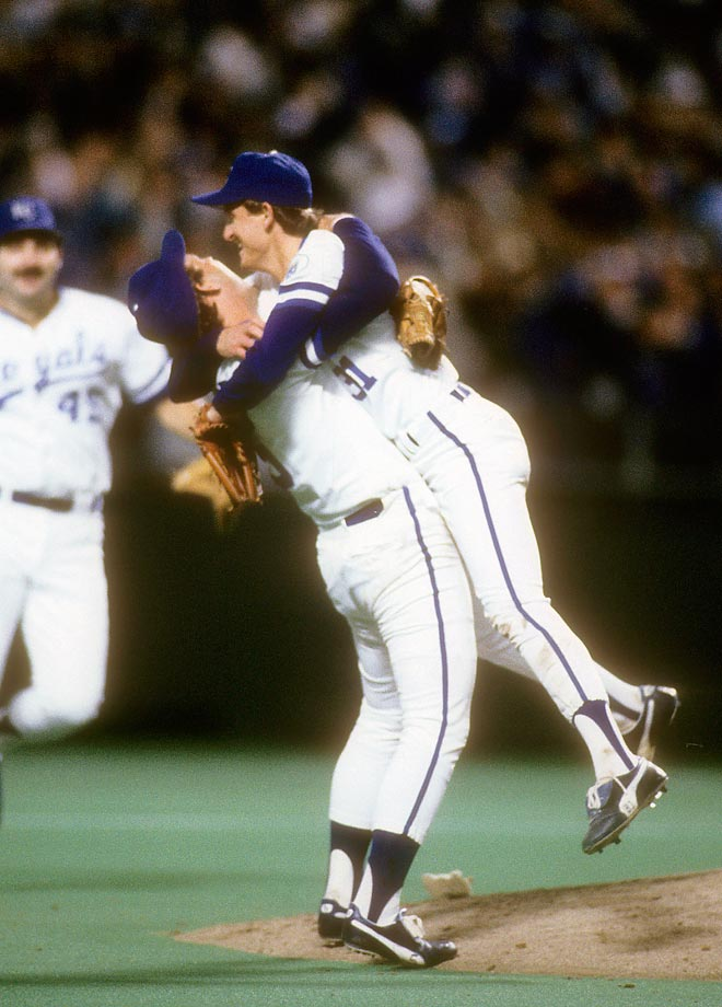 Bret Saberhagen and George Brett celebrate after Saberhagen pitched an 11-0 shutout in Game 7 to win the World Series. He was named the series MVP for his wins in Game 3 and Game 7.