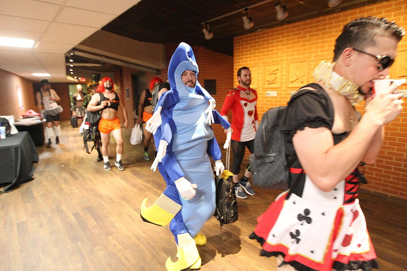 Rookie members of the Milwaukee Brewers walk to their bus in Alice in Wonderland outfits after defeating the Cardinals 8-4 at Busch Stadium.